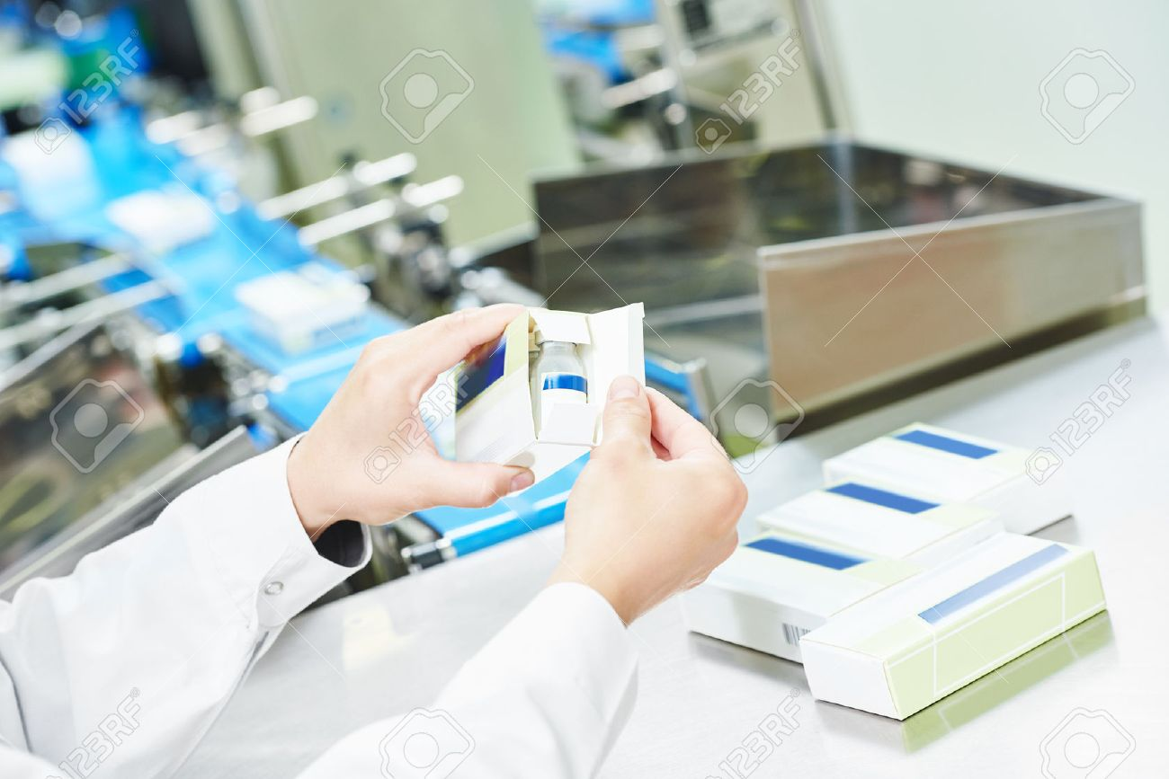 47388399-pharmaceutical-factory-worker-at-pharmacy-industry-manufacture-packing-medicine-into-boxes