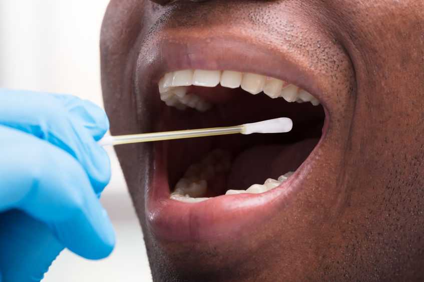 Dentist Cleaning Teeth With Cotton Buds